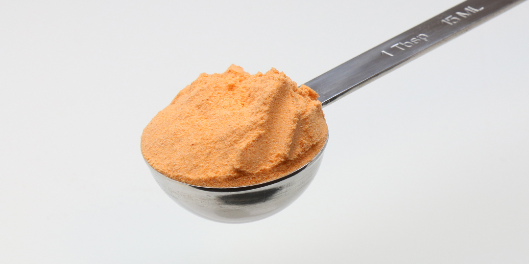 Cheese powder in a tablespoon