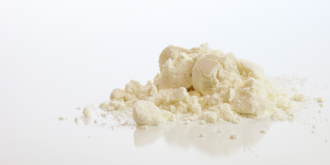 Whey Protein Powder pilled on a white table